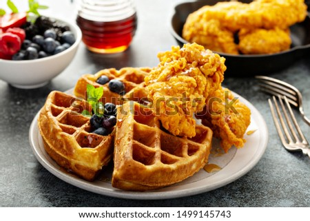 Waffles with fried chicken and maple syrup, southern comfort food Stock fotó ©