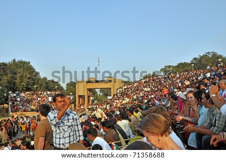 WAGAH BORDER, INDIA - 25 OCTOBER: Visitors of the ceremonial on indo-pakistan border on October 25, 2009. Ceremonial is famous for opening and closing the gate between both states.