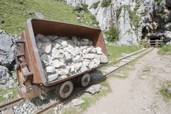 wagon of old abandoned mine in the lakes of Covadonga, National Park Picos de Europa,  Cangas de Onis, Asturias, Spain