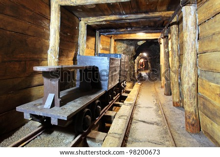 Wagons and machine in gold, silver and cooper mine
