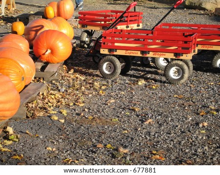Wagons and pumpkins on a fall day at a New England farmstand