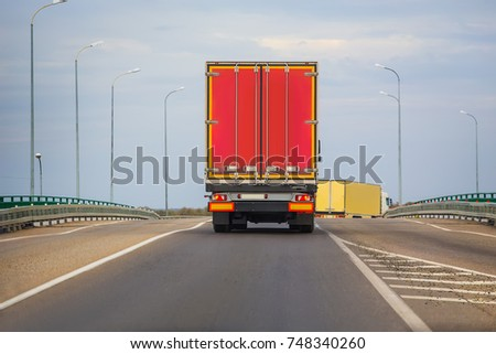 Wagons move in the evening on a country highway #748340260