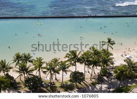 Waikiki Beach as viewed from our hotel room lanai. - stock photo