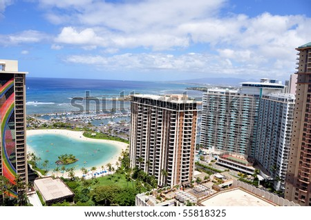 Waikiki beach is known as the world's greatest beach. Resort hotels stand behind the wide stretch of sandy beach that flows up to Diamond Head crater. - stock photo