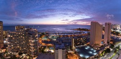 Waikiki city lights at sunset including views of the Ala Wai Small Boat Harbor, Magic Island, Hilton Hawaiian Village, Ilikai Hotel, Modern Honolulu, and Prince Hotel Honolulu