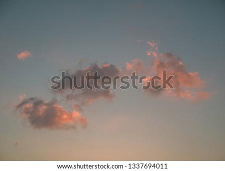 Waikiki Sunset from Honolulu, Hawaii.  Pale fire pink sunset with turquoise sky backdrop.