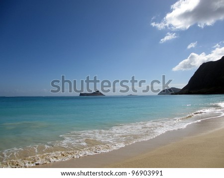 Waimanalo Beach on Oahu, Hawaii. With  rabbit and rock island seen in the distance
