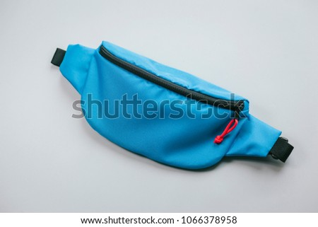 Waist bag of banana of blue colour on a white background isolation #1066378958