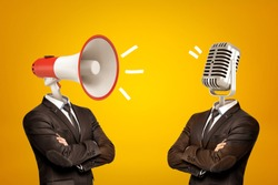 Waist-deep view of two businessmen standing in half-turn, arms folded, with megaphone and microphone instead of heads. Opinion leaders. Media influence public opinion. Media and people.