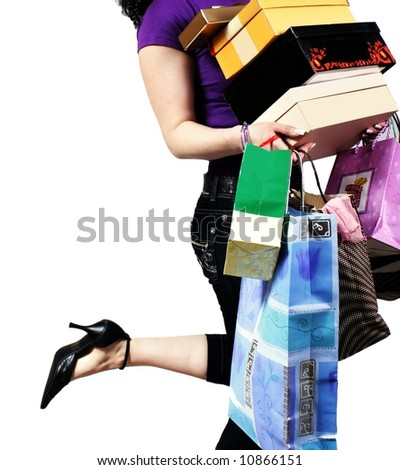waist-down view of woman carrying shopping bag - stock photo