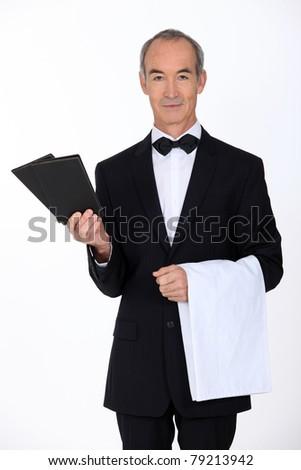waiter bringing the menus - stock photo
