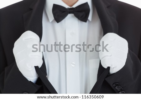 Waiter clinging at his jacket in front of camera