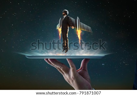 Waiter hand holding an empty digital tablet with Businessman wear a rocket suit to lift , Business success concept .