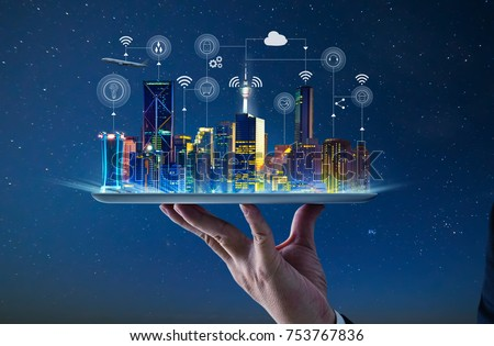 Photo of  Waiter hand holding an empty digital tablet with Smart city with smart services and icons, internet of things, networks and augmented reality concept , night scene .