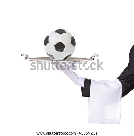 Waiter holding a silver tray with a football on it isolated on white background