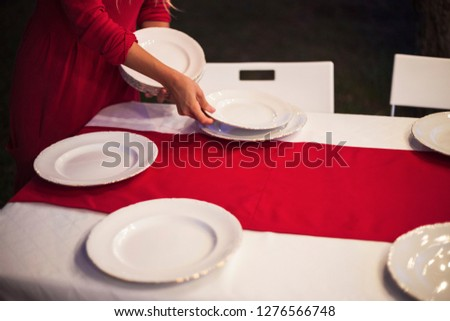 waiter in restaurant and table setup, reception layout