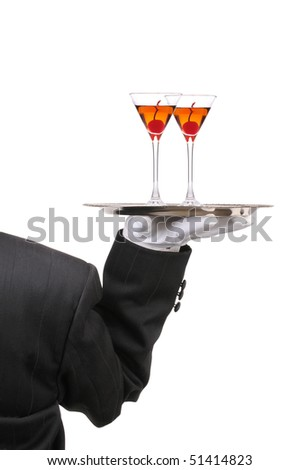 Waiter in Tuxedo seen from behind with two Manhattan Cocktails on serving tray held at shoulder height vertical format over white