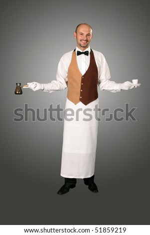 Waiter in uniform with percolator and cup of coffe. - stock photo