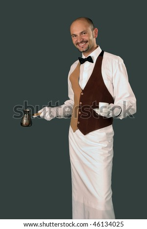 Waiter in uniform with percolator and cup of coffee.