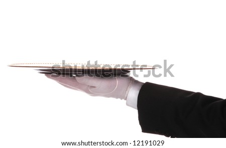 Waiter or butler with a serving tray on outstretched arm isolated over white.