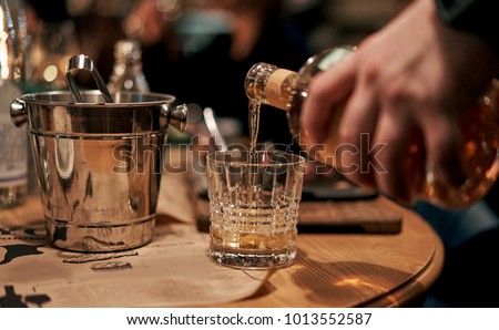 waiter pours alcoholic beverages in the restaurant #1013552587