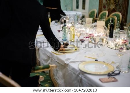 Waiter serves cake #1047202810