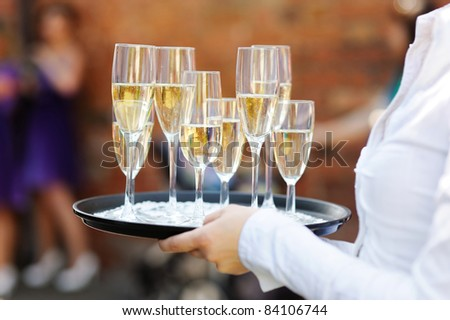 Waiter serving champagne at festive event