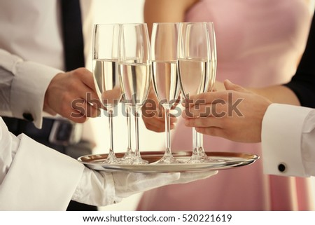 Waiter serving champagne during  buffet catering party, close up view #520221619