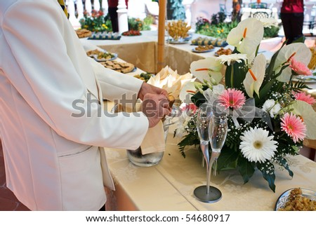 stock photo Waiter serving champagne on wedding buffet