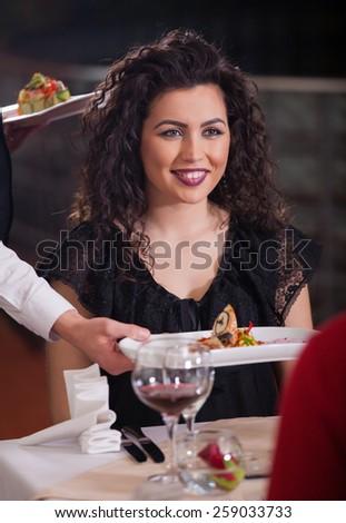 Waiter serving food in a restaurant