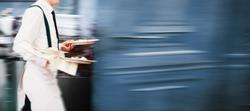 Waiter Serving In Motion On Duty in Restaurant Long Exposure | Copyspace