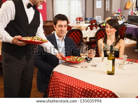Waiter serving sea food to a  Waiter Serving Food