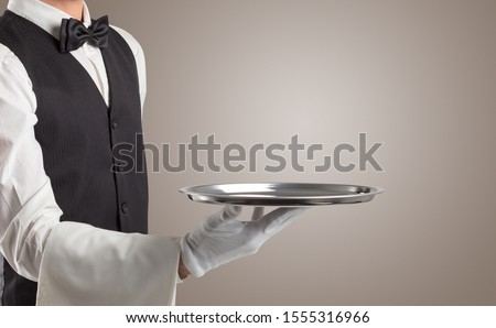 Waiter serving with white gloves and steel tray in an empty space Stock photo ©