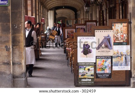 Waiter standing at a restaurant in Paris, France,