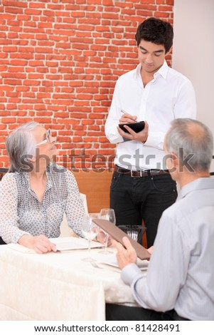 Waiter taking order in a restaurant