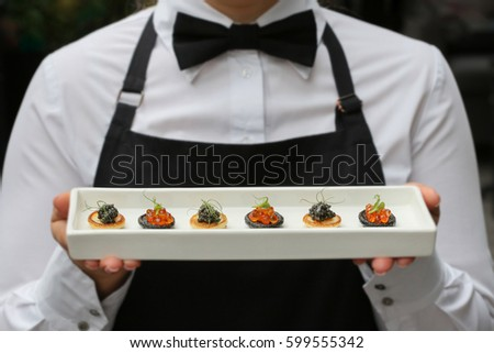 waiter with canapes / canapes with caviar / catering Photo stock ©