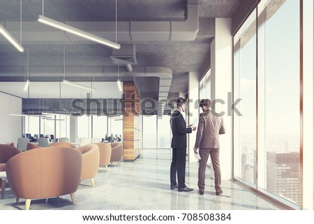 Waiting area of an office with beige armchairs standing around coffee tables in an office lobby with panoramic windows. A conference room background. Loft, men 3d rendering toned image