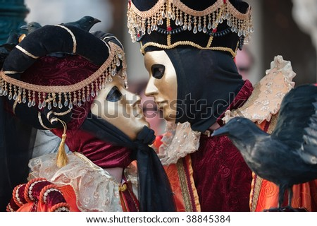 Waiting for a kiss, carnival in Venice