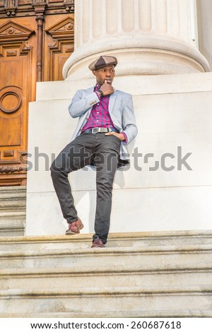 stock-photo-waiting-for-you-wearing-newsboy-cap-dressing-in-blazer-pants-leather-shoes-a-young-black-guy-260687618.jpg