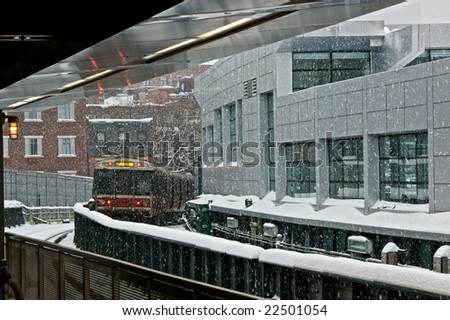 waiting on the train platform at charles street station during a snow storm in boston massachusetts