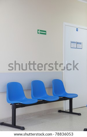 waiting room - blue chairs, door