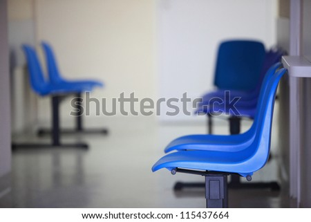 waiting room blue chairs, door on the floor