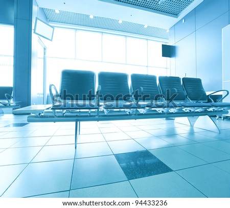 waiting room with seats in the airport - stock photo