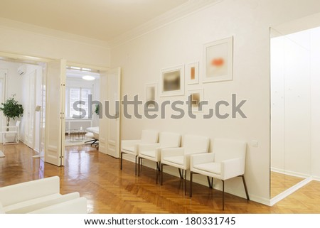 Waiting room with white furniture