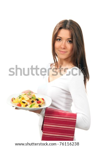 Waitress, chef  holding plate with italian lemon pappardelle, tagliatelle, macaroni, spaghetti pasta with tomato, shrimps and olives on serviette, table napkin in other on a white background