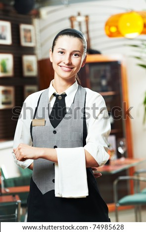 Waitress girl of commercial restaurant in uniform waiting an order