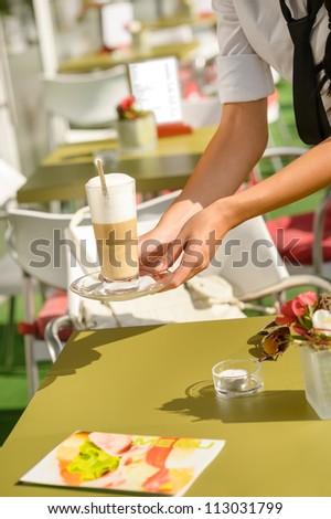 Waitress hands close up serving latte cafe bar terrace sunny