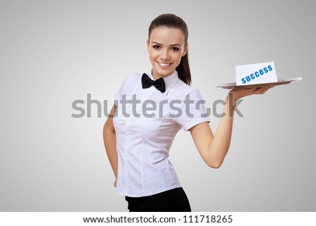 Waitress holding a tray with word success on it