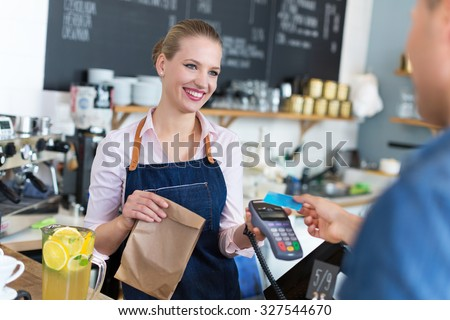 Waitress serving customer at the coffee shop  Photo stock ©