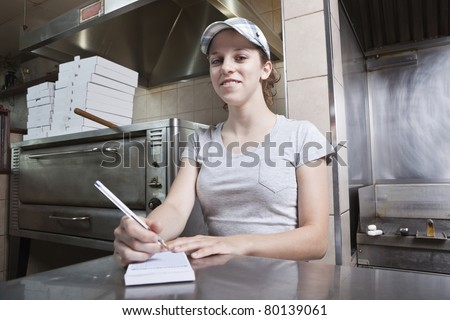 Waitress taking order in a fast food restaurant